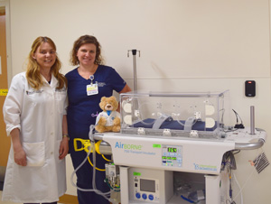 Doc with neonatal transport isolette