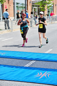 Dana Deighton and Tiffani Tyer crossing finish line