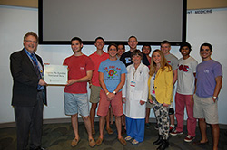 Sigma presenting check to Dr. Czinn